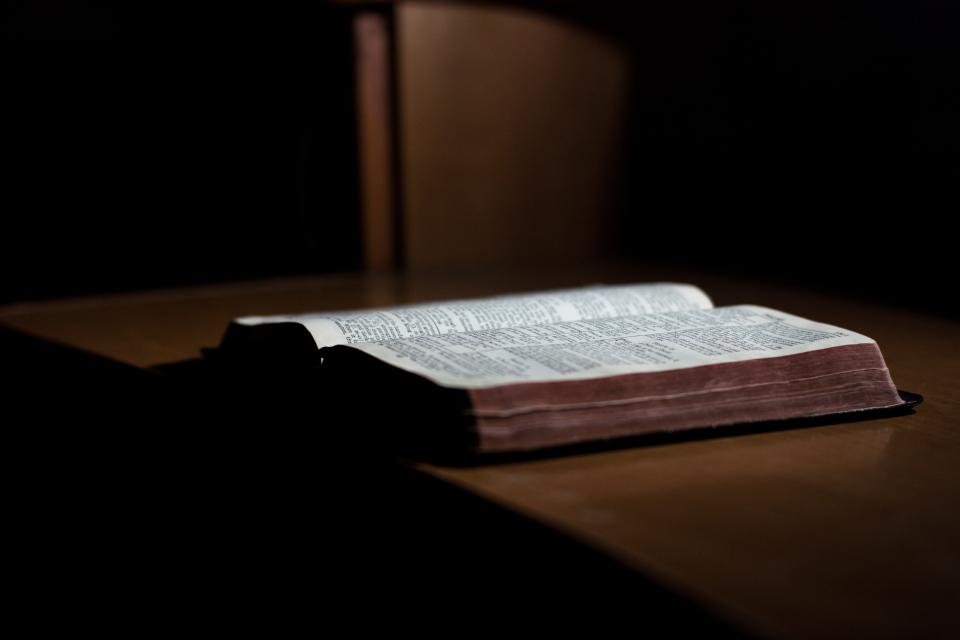 book bible reading table dark room