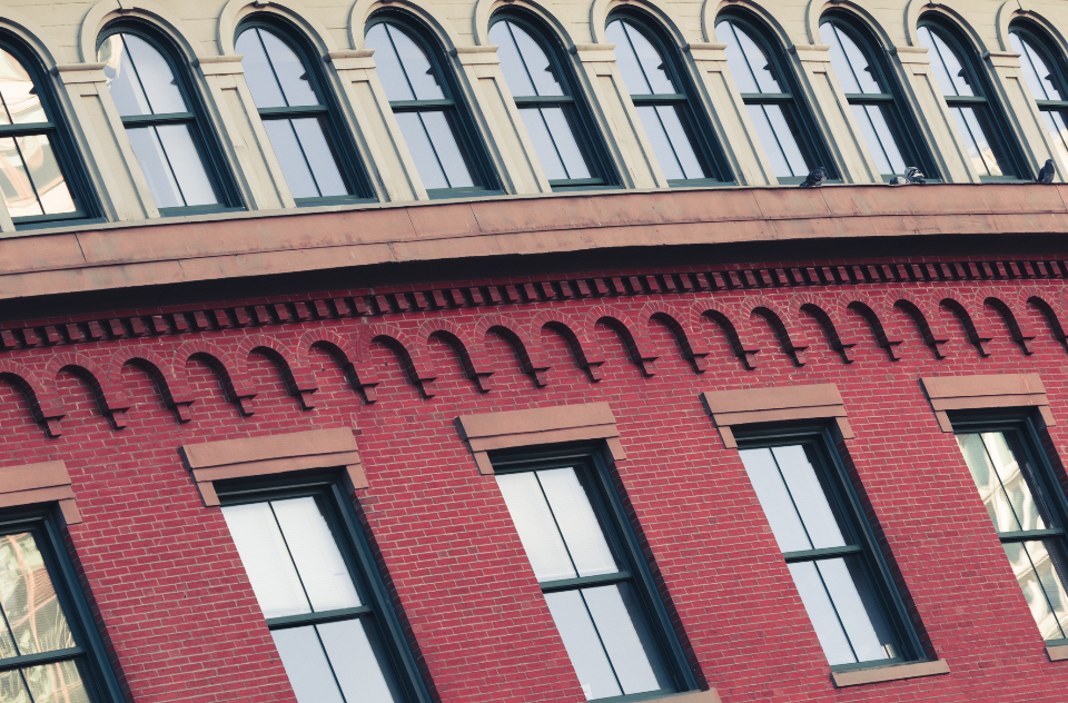 building exterior city urban windows old architecture ornate brick pattern design business office wall