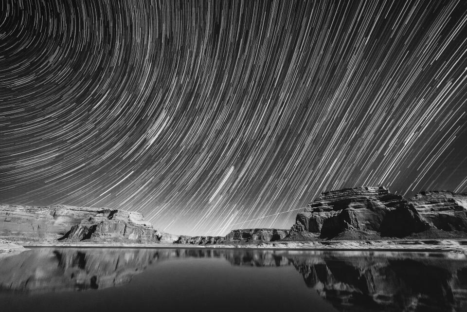long exposure photography dark night star sky mountain landscape nature monochrome black and white reflection rocks formation travel adventure