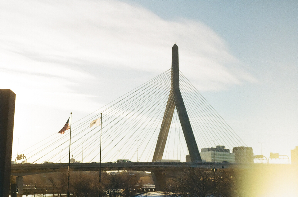 bridge abstract city angle architecture structure modern cable lines tower sky clouds design travel street lights flags flare