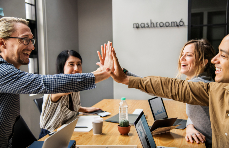 achievement cheerful collaboration colleague communication computer connection cooperation deal digital device diverse european expression friends give me five giving greeting group hands happiness high five hit laptop man meeting network