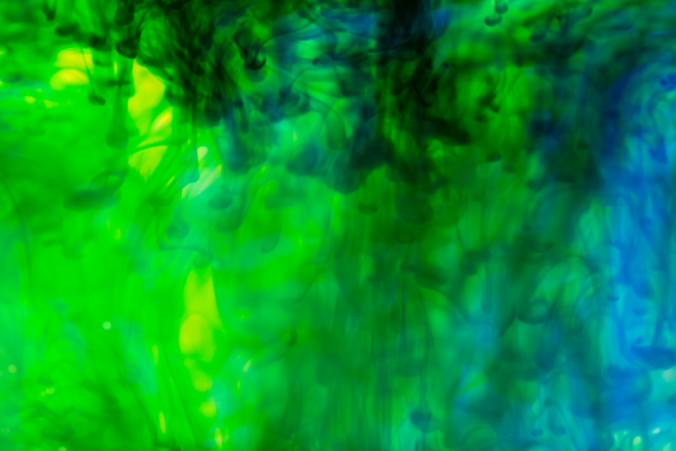 ink water liquid swirl abstract background motion suspended drop art underwater creative paint flow yellow green oil blue