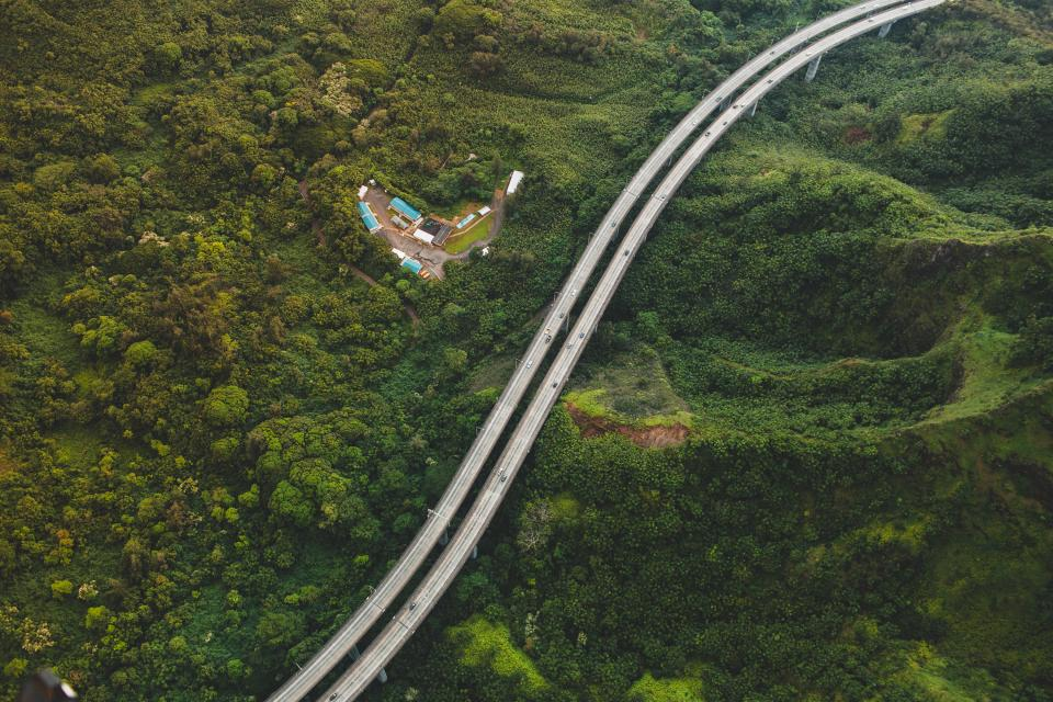 green grass trees aerial view bridge structure road highway highland mountain nature landscape