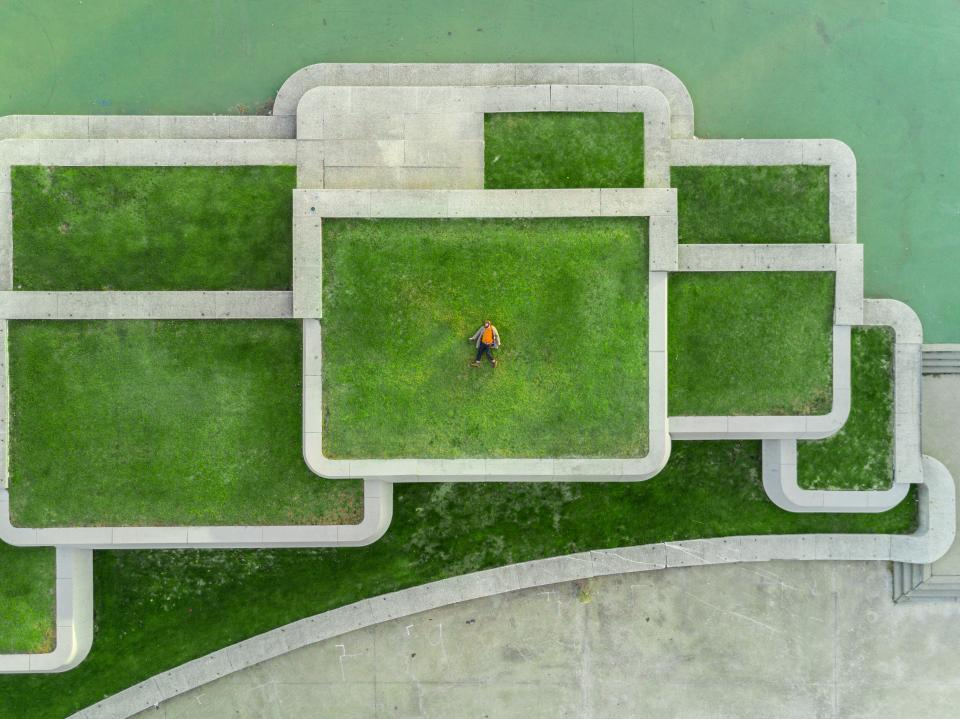 green grass field architecture people alone aerial