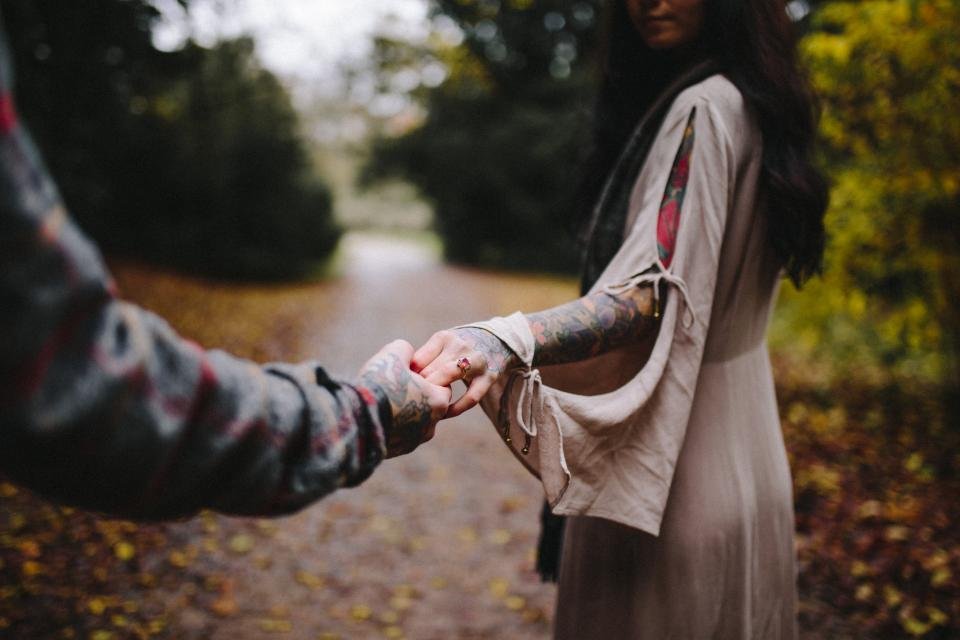 holding hands couple people guy girl ring tattoo nature blur bokeh