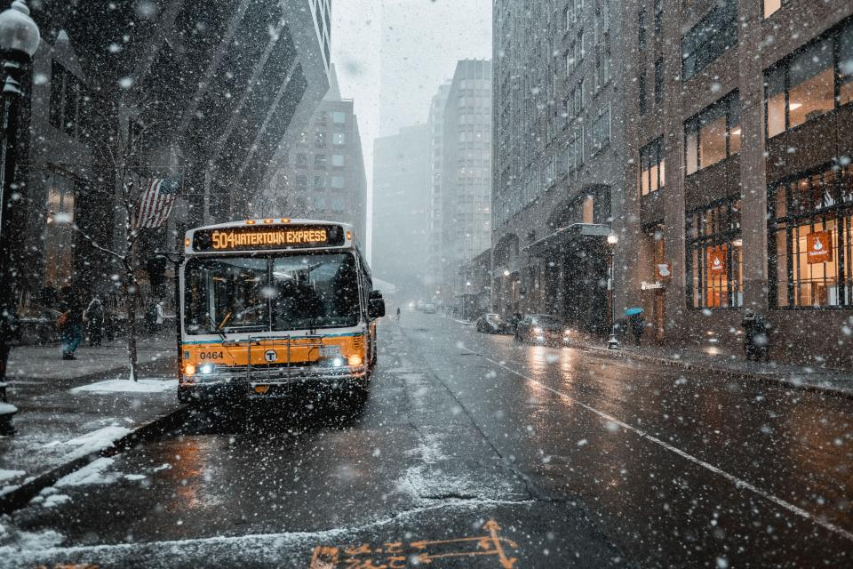 architecture building infrastructure city urban road street bus vehicle transportation rain snow winter