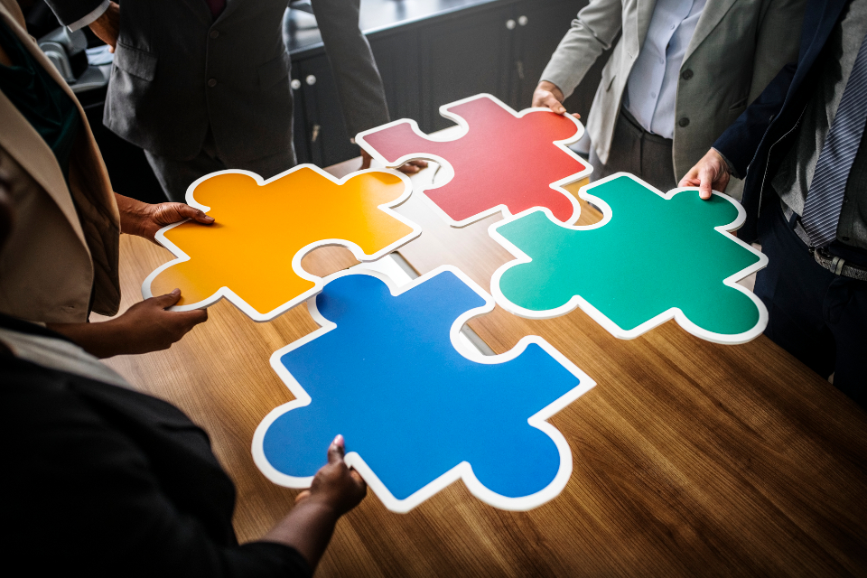 blue business business people collaboration colorful communication connected connecting connection cooperation green group holding inspiration jigsaw join joining laying man meeting meeting room merging network office partnershi