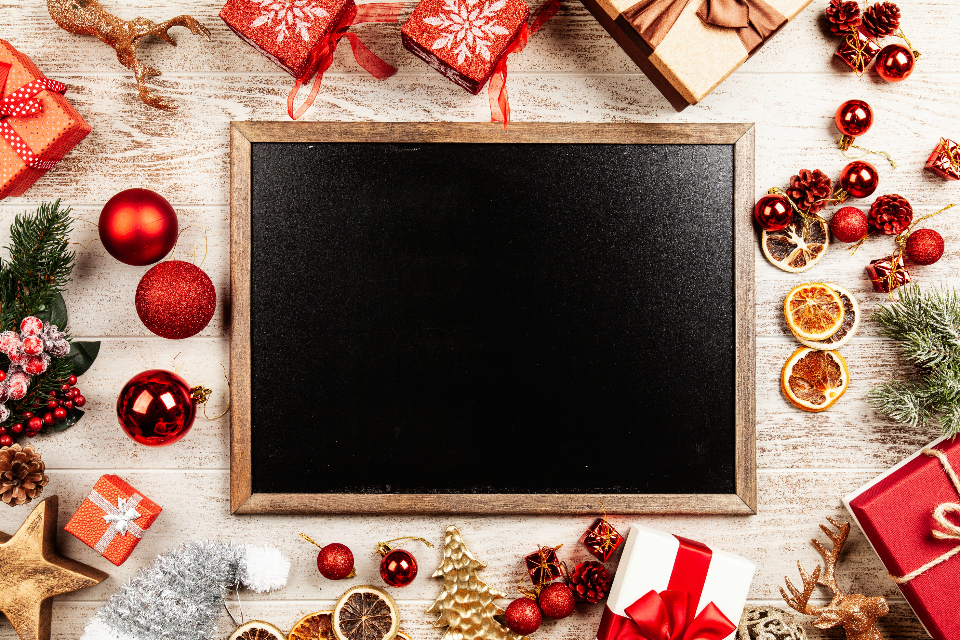gift box Christmas present celebration holiday seasonal background wooden old table abstract top view flat lay open closed ribbon wrapping black board blackboard chalkboard copyspace frame