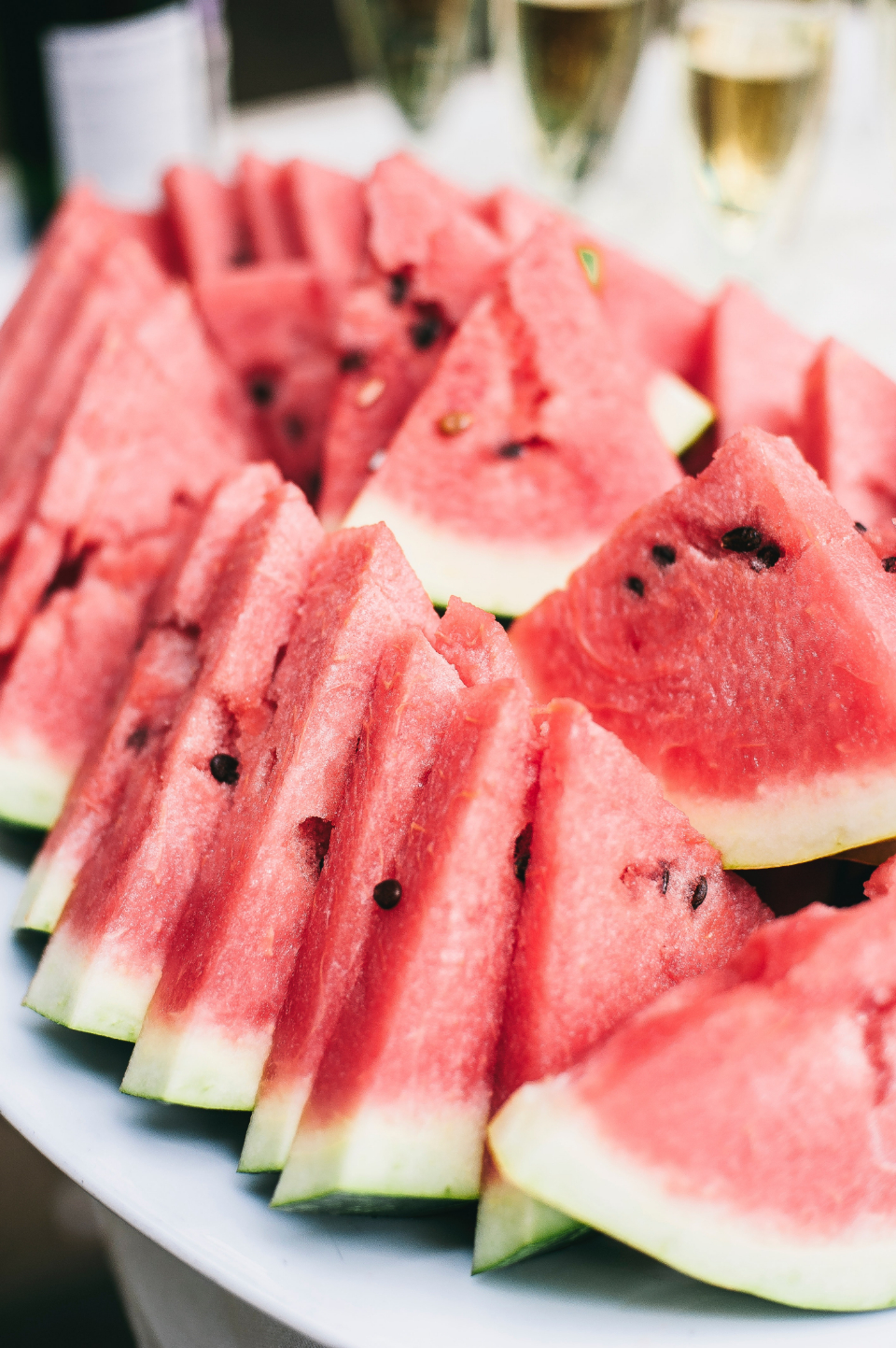 fresh sliced watermelon fruit red pip food plate close up