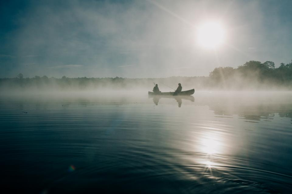 boat lake water canoe boating people fishing fisherman sunrise dawn fog foggy nature outdoors