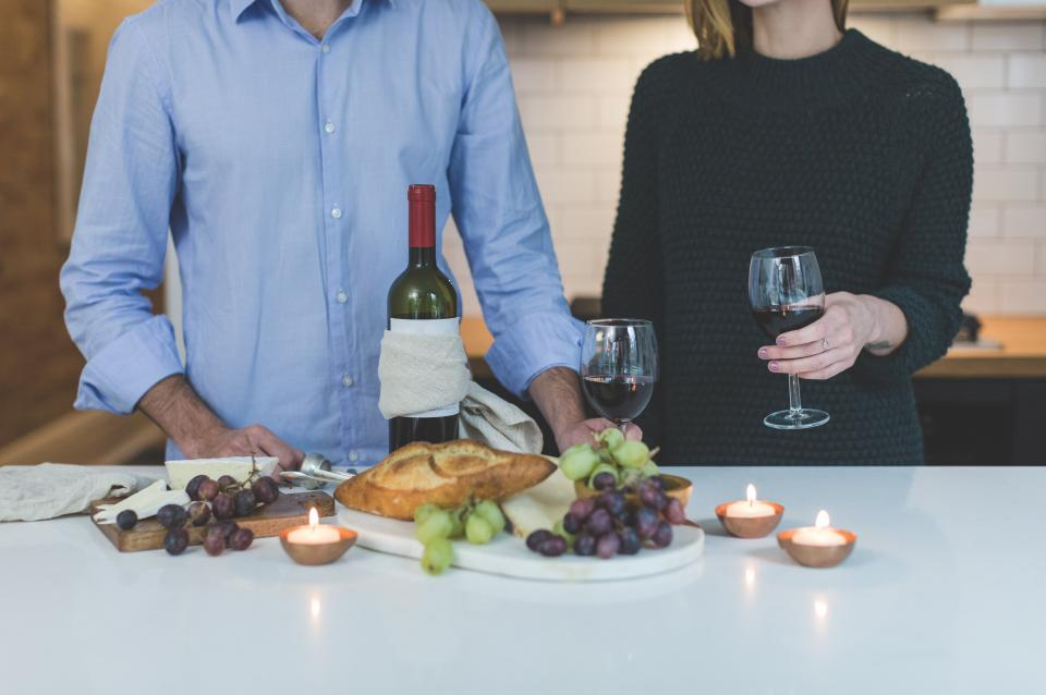 people man woman glass wine fruits healthy candle kitchen couple date