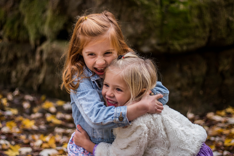 children happy cuddle smile blonde girl play garden hugging