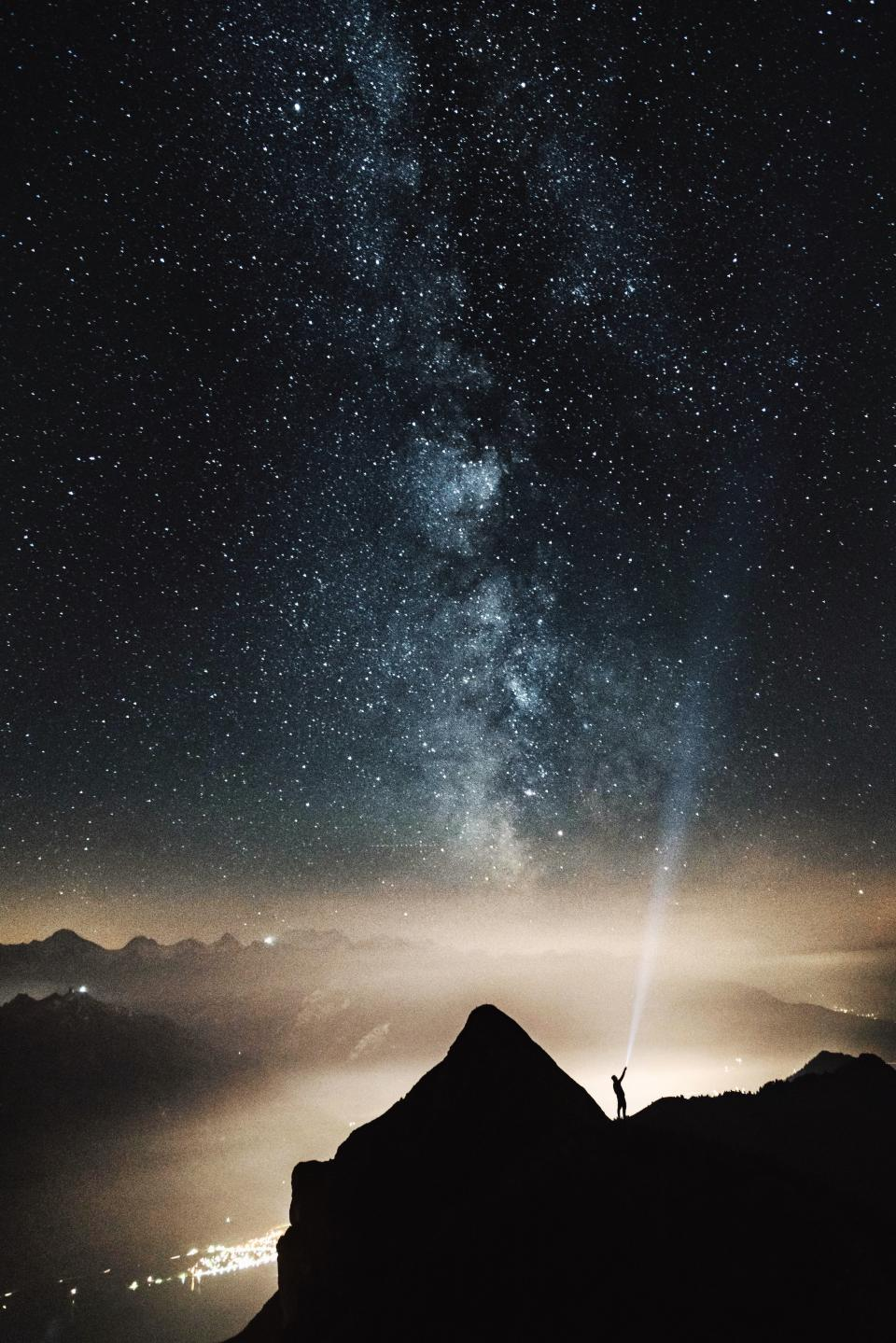 mountain valey hill people man alone dark night flashlight stars galaxies light