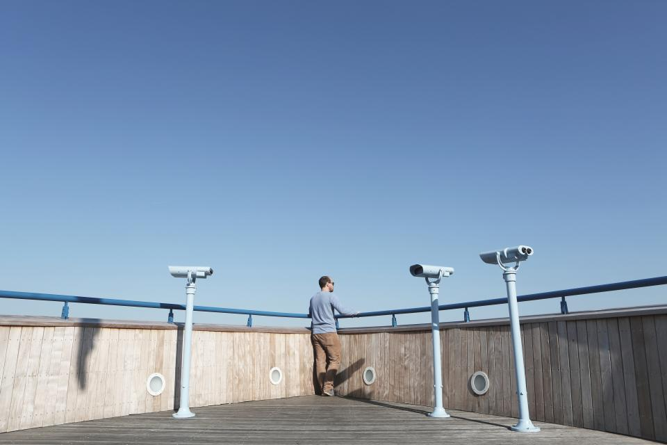 guy man looking lookout rooftop blue sky sunshine tower viewer