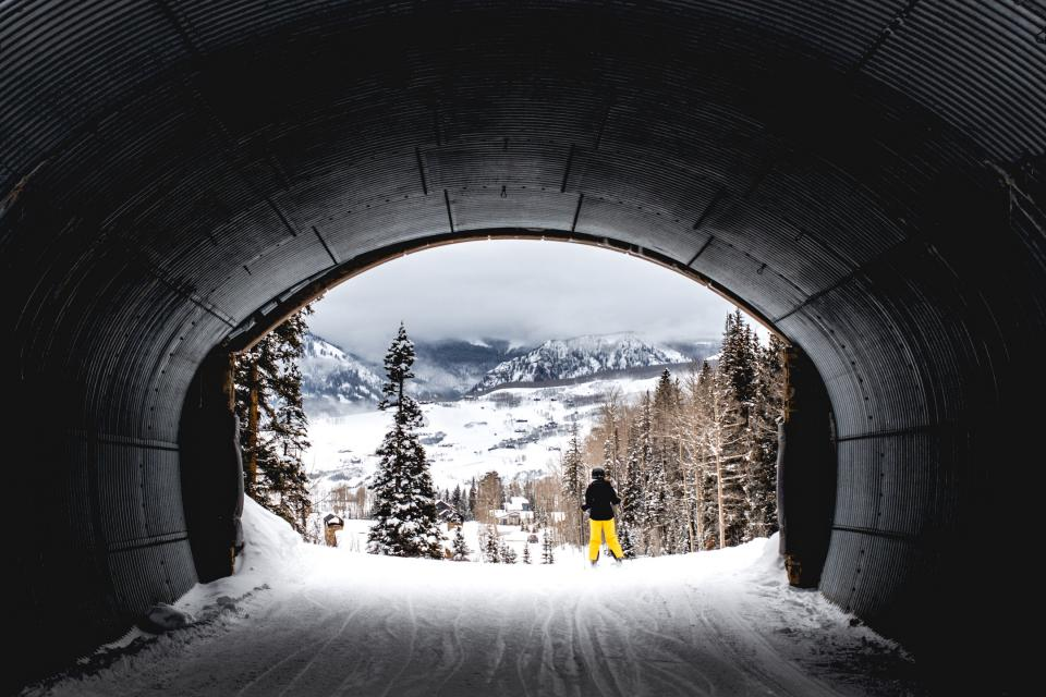 tunnel nature trees winter snow mountains skiing people downhill