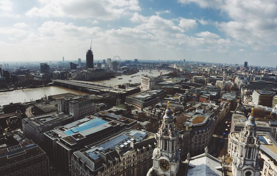 London England city buildings rooftops aerial view sky clouds