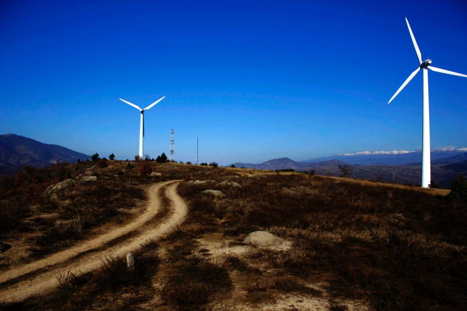 highland landscape mountain nature travel outdoor blue sky windmill electricity farm