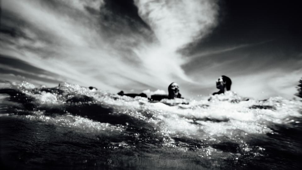 sea ocean water waves nature black and white people girls swimming clouds sky