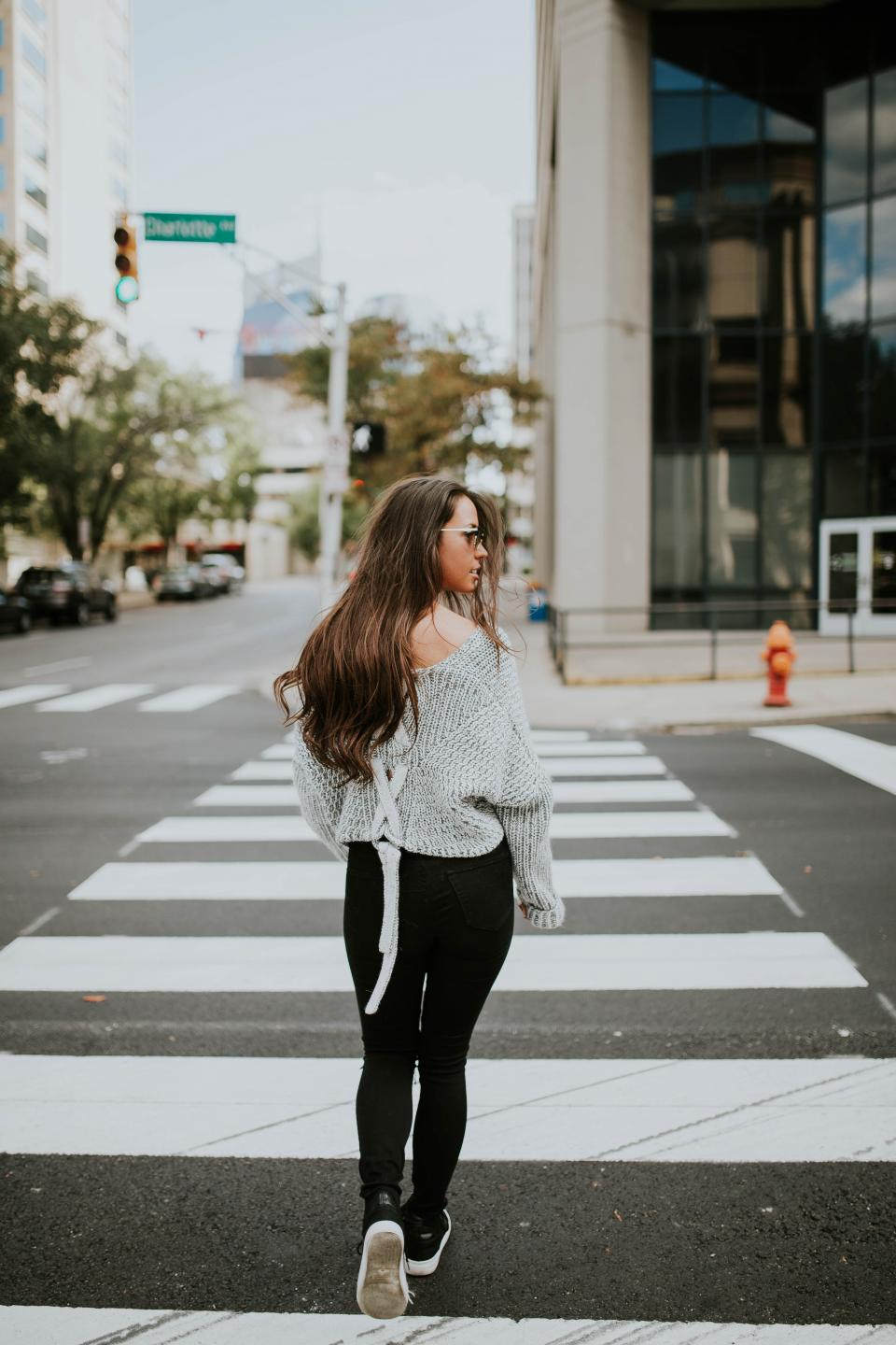 people girl woman walking pedestrian street city buildings blur sunglasses clothing fashion model travel
