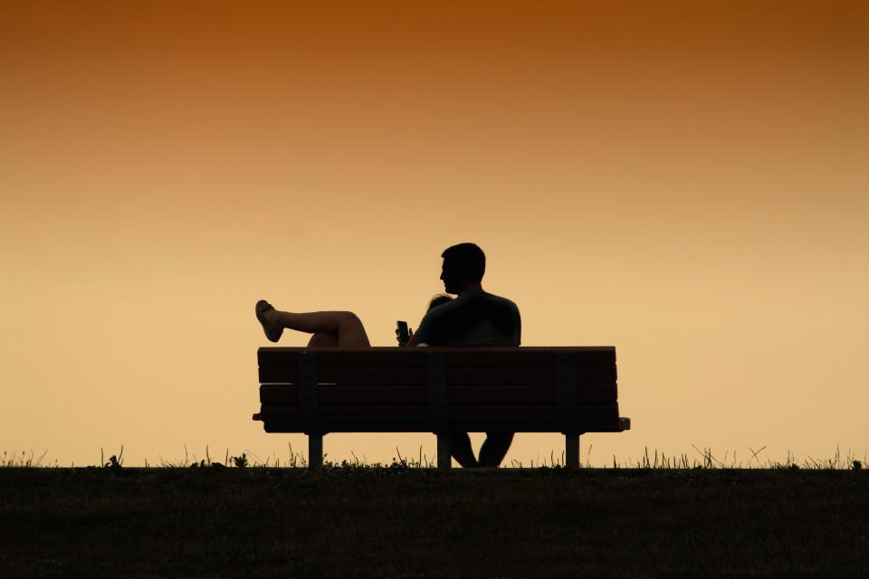 bench couple sunset grass park people man woman silhouette sweet love