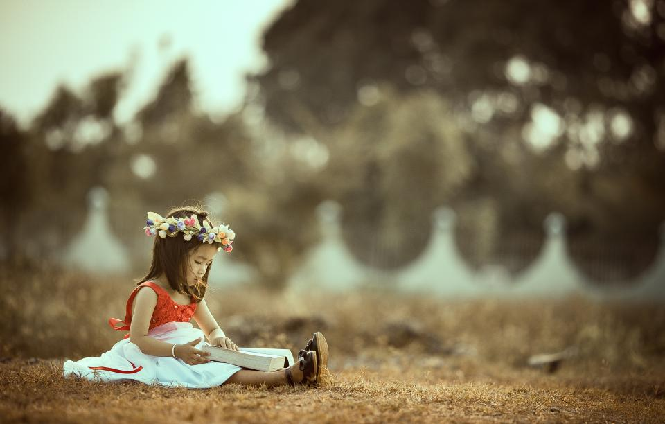 people girl child kid alone grass reading book bokeh
