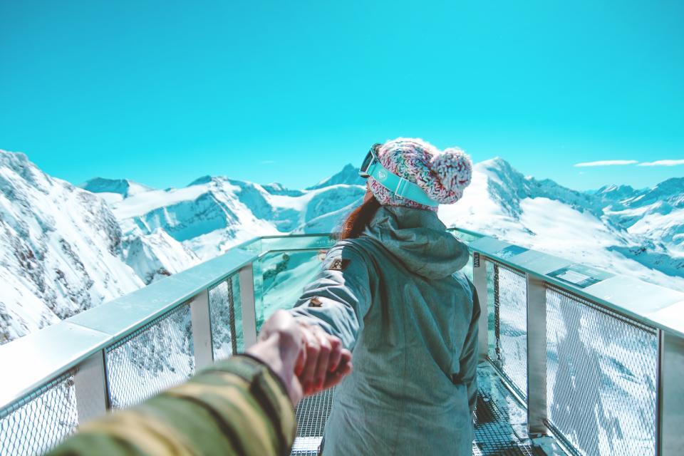 mountain highland blue sky summit ridge landscape nature valley hill snow winter view travel people couple holding hands girl