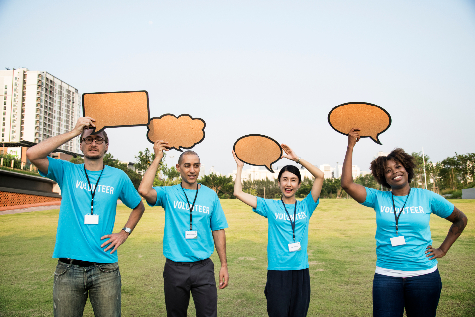 attention charity chat cheerful communication community conversation diverse donation european friends fundraising group japanese kindness man message ngo non profit notice notification organization outdoors park