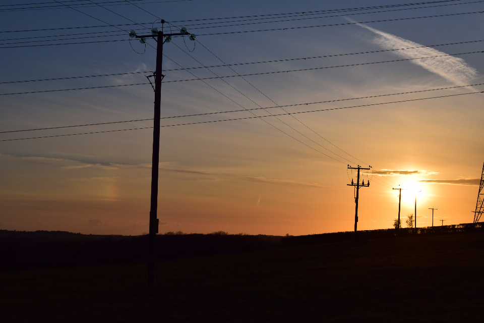 sunset powerlines wales silhouette