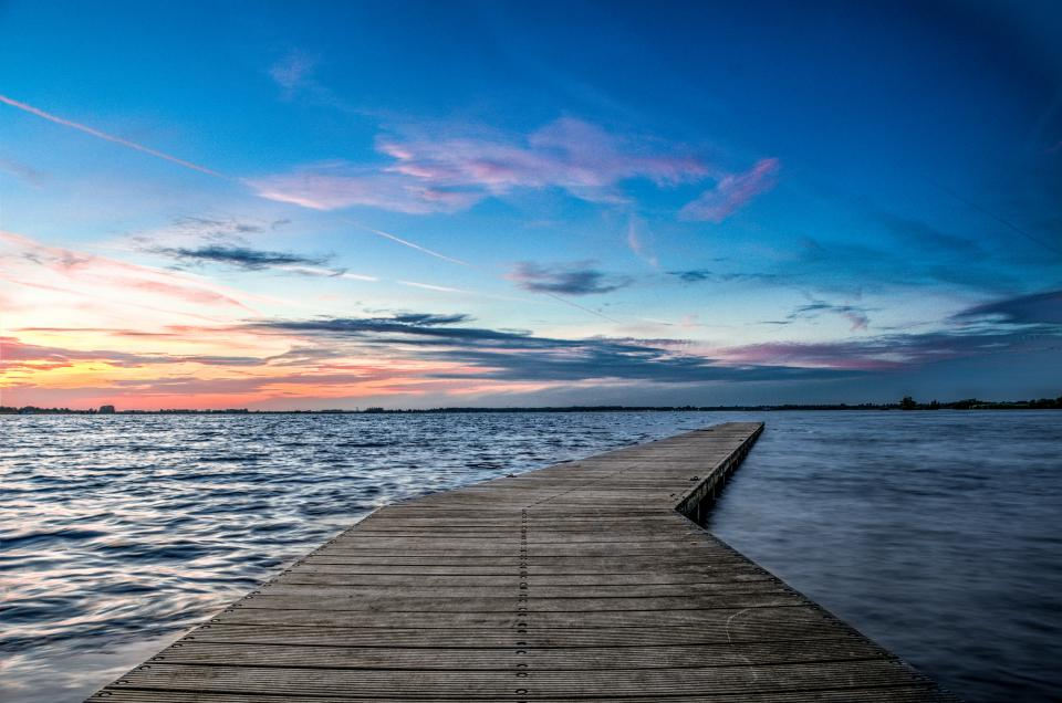 pier dock lake water horizon sunset dusk sky blue landscape nature outdoors evening