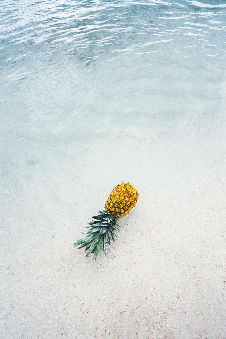 pineapple dessert food appetizer fruit juice beach ocean sea white sand