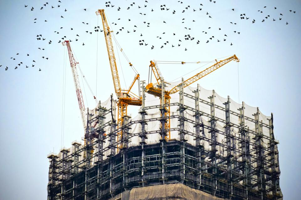 building construction cranes tower real estate sky birds