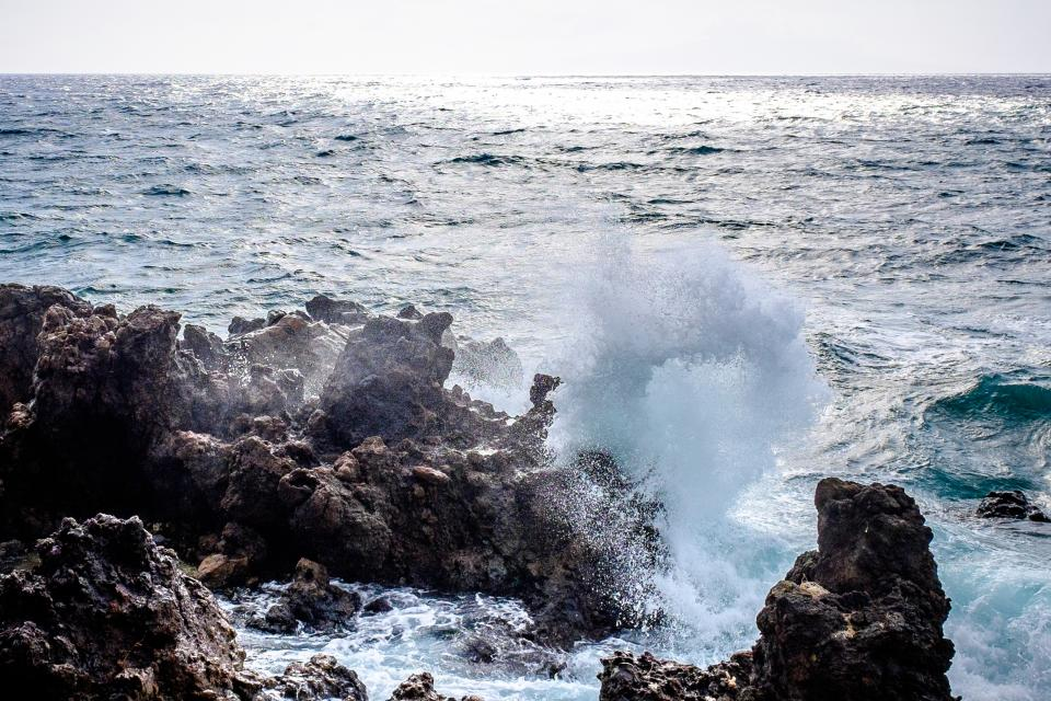 sunny summer sea ocean blue crashing water waves splash rocks nature