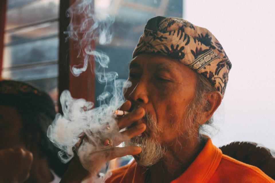 people old man smoking cigarette