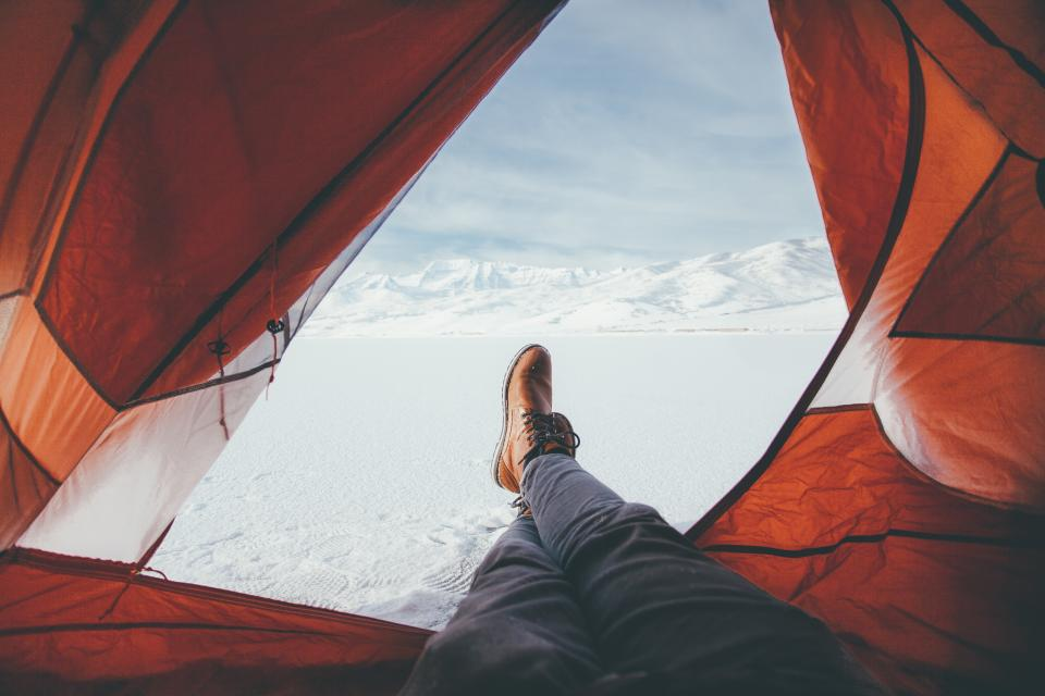 leather shoe footwear leg travel tent snow winter cloud sky mountain outdoor