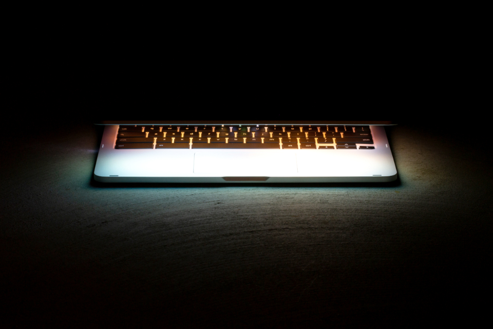 laptop keyboard glow black background copy space industrial computer pc electronic internet connection data network typing business application software hardware illuminated light dark isolated object mobile office equipment technology