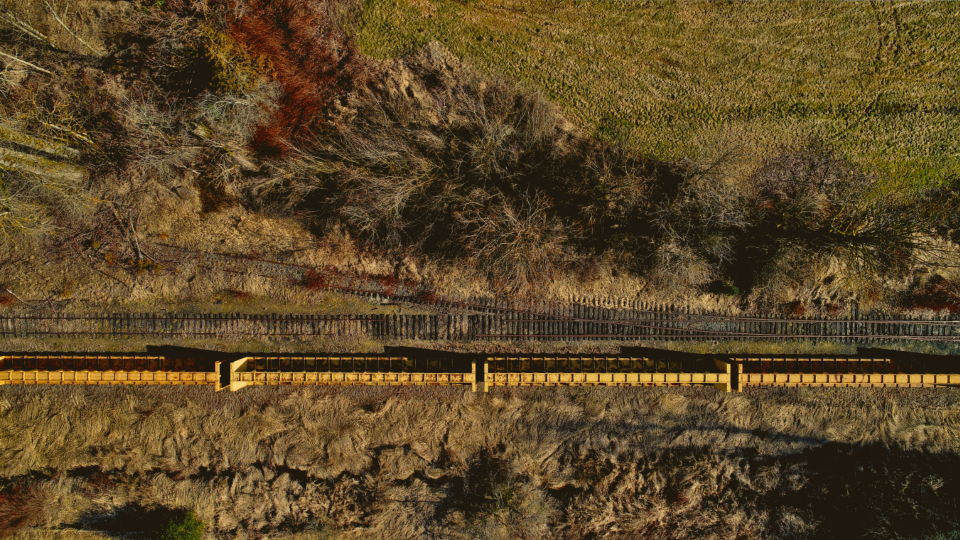 aerial train tracks rural landscape drone above terrain transport travel