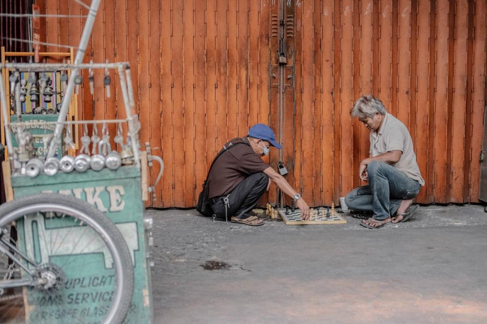 people man old street chess board game play