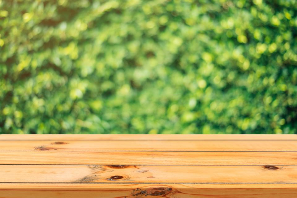 wood wooden table outside bokeh blur green