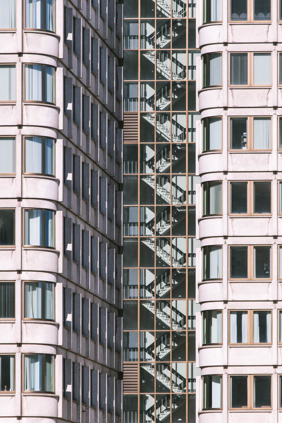 city architecture building windows exterior pattern facade tall stairwell stairs apartments business classic design