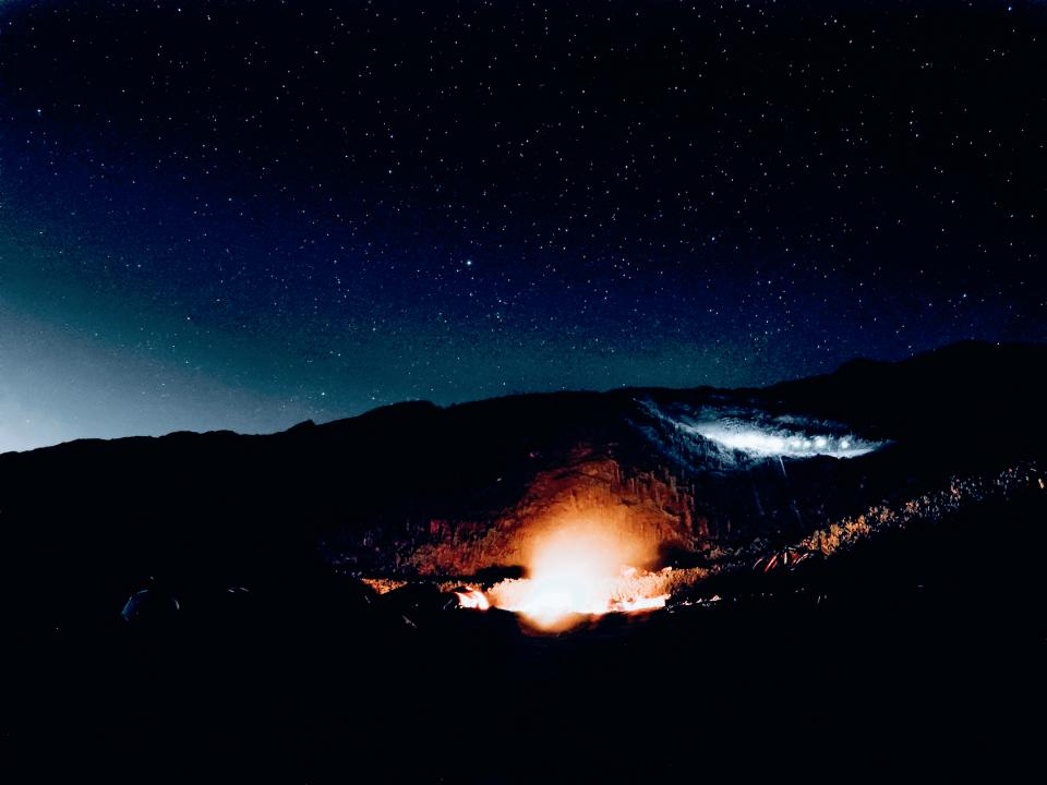 landscape fire night stars mountains nature