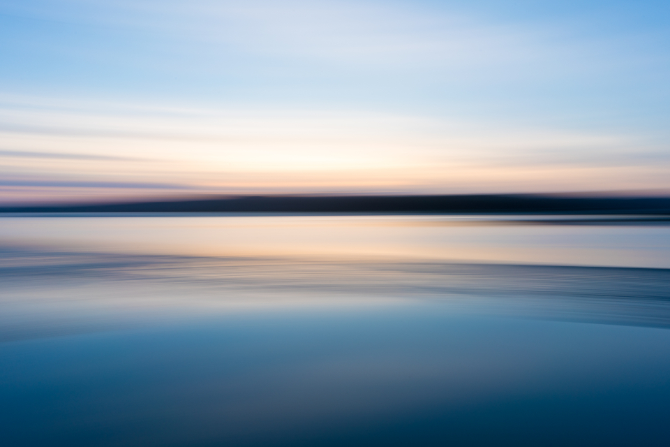 sky water horizon background lake ocean blue soft focus motion landscape sun light natural abstract nature reflection