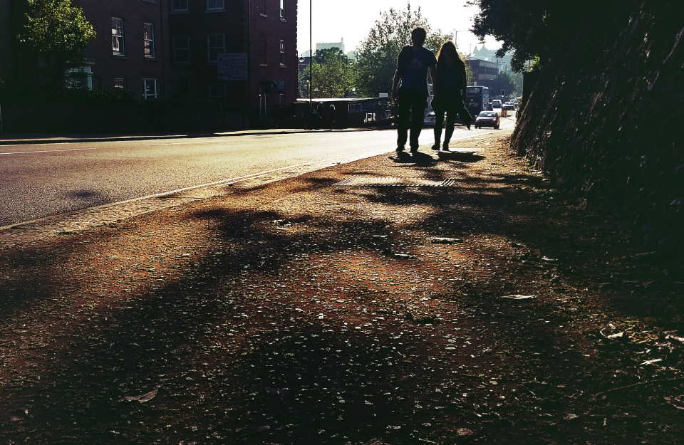 street people couple road silhouette shadows sunlight