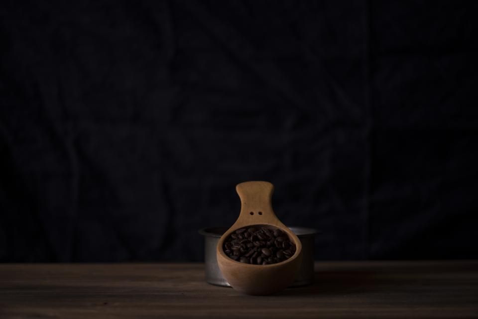 dark room table wooden scoop coffee beans seed