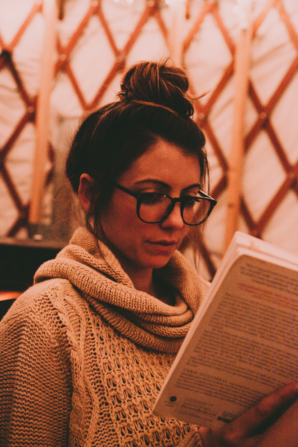 woman glasses reading book jumper close up intelligent thoughtful paper people female student teacher