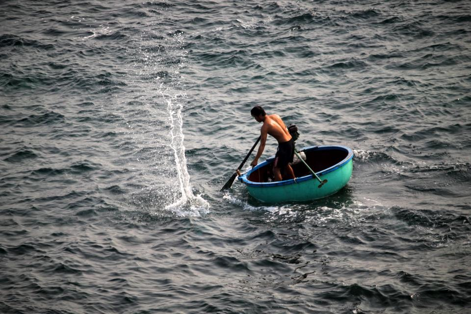 people man boat sailing paddle fishing sea ocean water splash