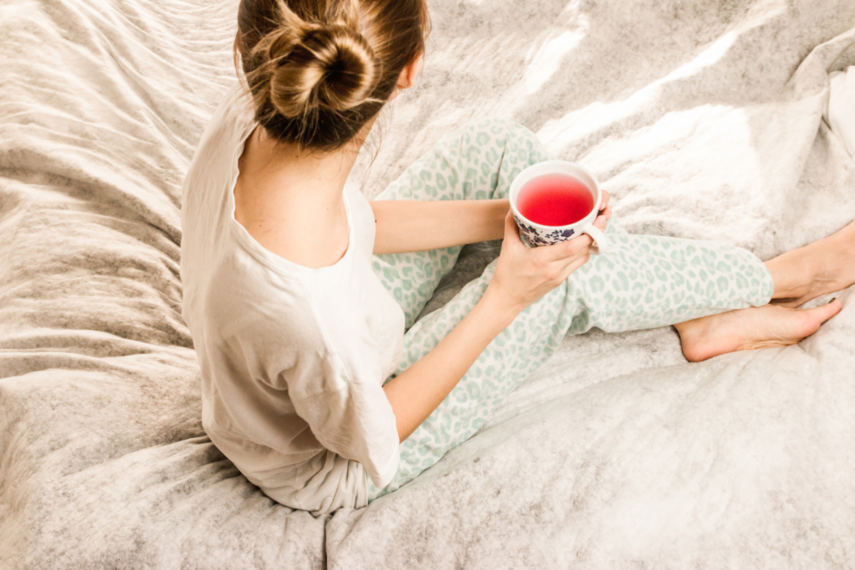 woman bed drink tea food pyjamas red pop juice feet hair