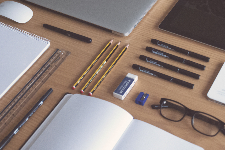 desk office flat lay tools writing computer laptop business freelance startup glasses notebook notes planning work workplace pens pencils