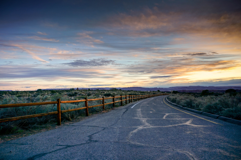 road sunset travel country sky clouds fence scenic trip field horizon mountains driving drive