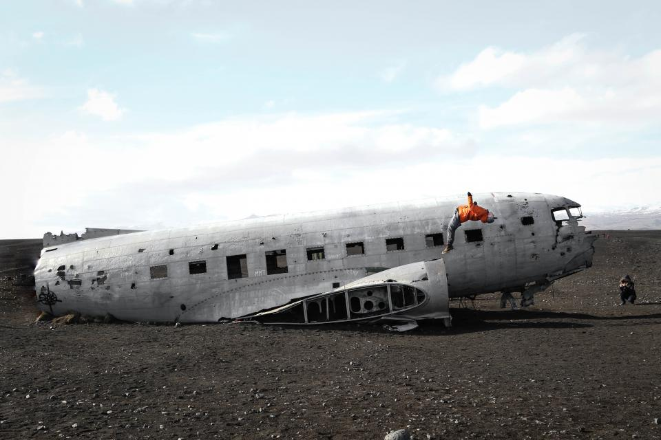 airplane airline parts. clouds sky window things items steel old wreck broken damage people travel tumbling