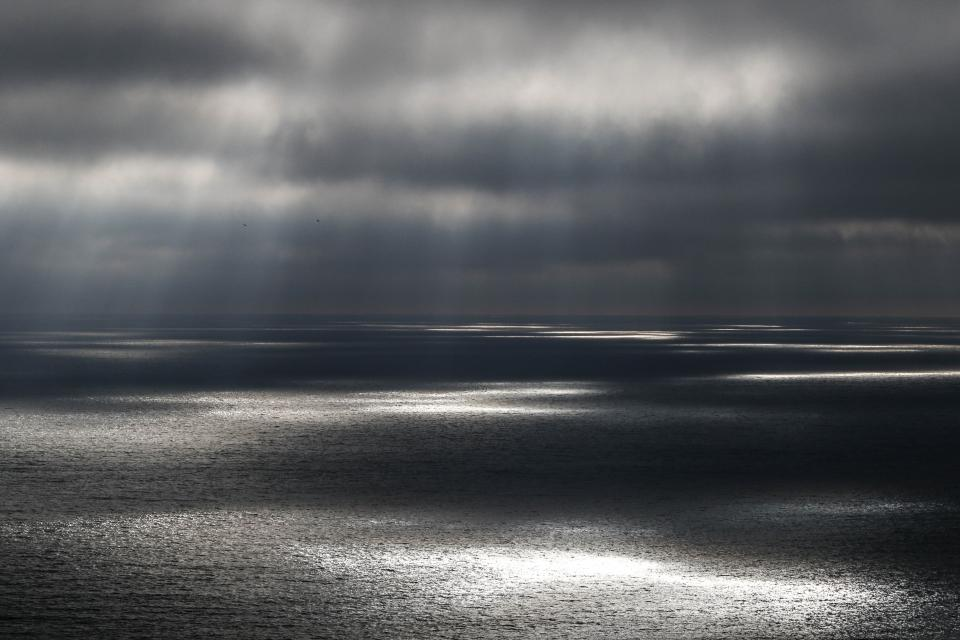 sea ocean water nature dark clouds sky